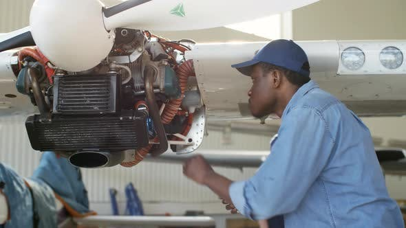 Cover Image for Black Aircraft Mechanic Working in Hangar