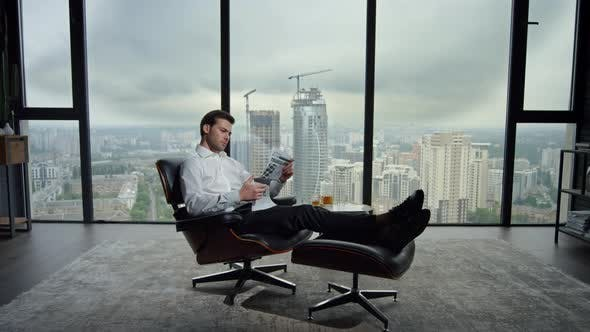 Thumbnail for Businessman Resting in Chair with Newspaper. Manager Reading Newspaper in Office