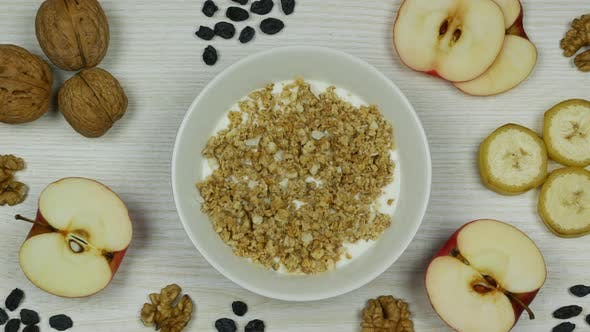 Thumbnail for Granola with Yogurt Breakfast. Preparation and Eating. Stop Motion Animation. Top View