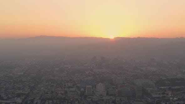Aerial of orange sunset light on cityscape