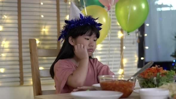 Girl celebrating her birthday alone