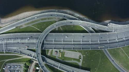 Aerial Copter View of Highway with Car Interchange Road, Urban Junction Freeway Traffic Spbd on Lake