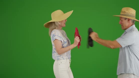 Thumbnail for Elderly Caucasian people playing with their sandals on green screen