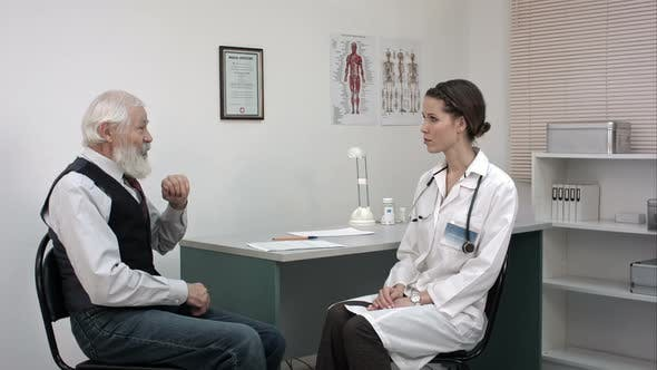 Thumbnail for Doctor Listening To Her Male Senior Patient at Office