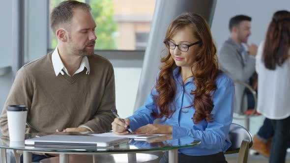 Thumbnail for Two young business people meeting