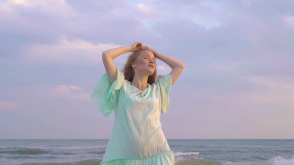 Thumbnail for Portrait of Young Woman with Red Hair Standing at the Beach Close Up. Cute Girl Spends Time Near