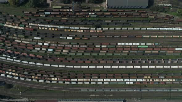 Thumbnail for Train Station with Freight Trains and Containers in Aerial View