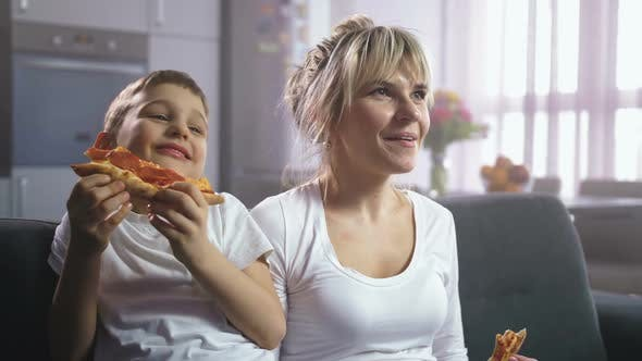 Thumbnail for Family Laughing Eating Pizza and Watching Cartoon