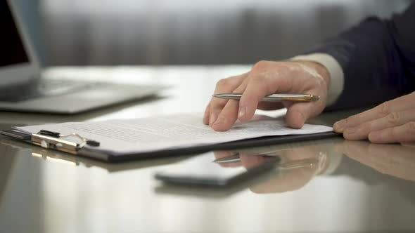 Thumbnail for Businessman Reading Carefully Terms, Conditions of Business Contract, Signing It