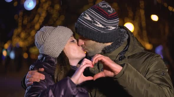 Thumbnail for Happy Couple Making Heart Shape with Hands Gesturing Romantic Commitment Enjoying Loving
