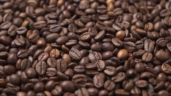 Dark Roasted Coffee Beans Move in a Circle