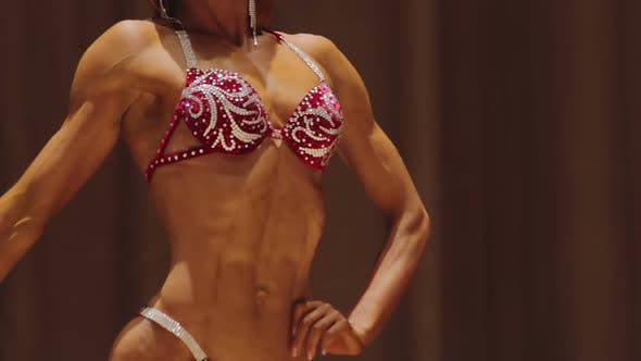Strong Female Bodybuilder With Hypermasculine Body Demonstrating Ripped Muscles