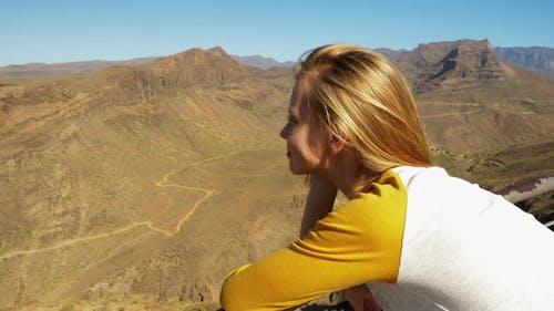 Blonde Beauty Leaning Over Railings Enjoying Gran Canaria Landscape