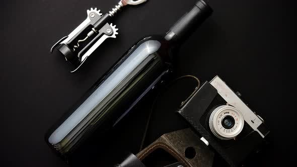 Thumbnail for Red Wine Bottle, Corkscrew and Old Photo Camera