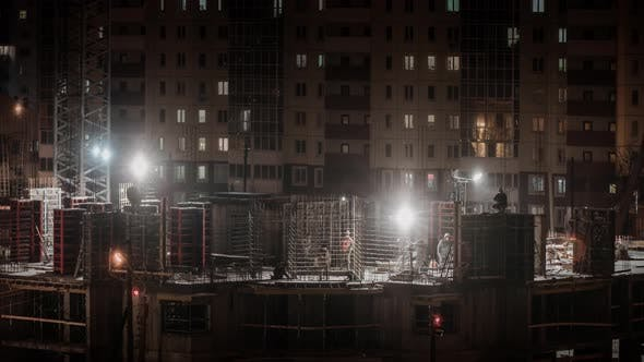 Thumbnail for Construction Site Residential Estate Building in City Constructors Working at Winter Night Snowing
