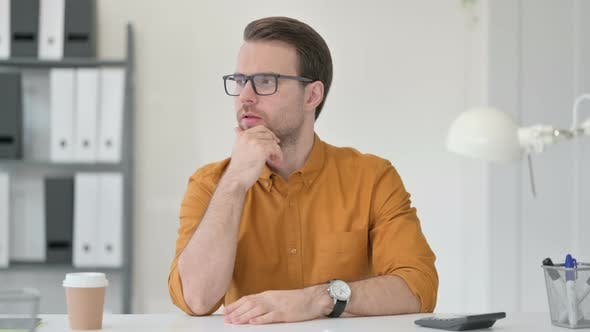 Thumbnail for Young Man Thinking in Office