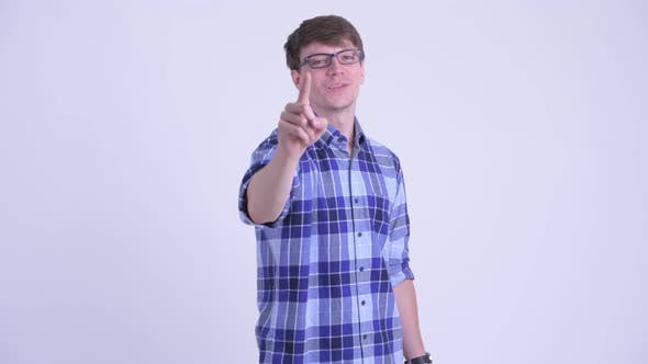 Cover Image for Happy Young Handsome Hipster Man Pointing at Camera
