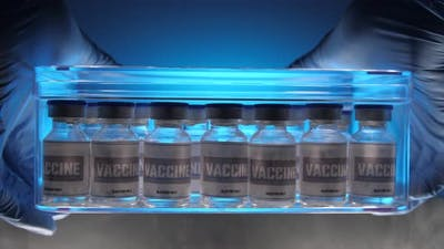 Glass vials for vaccine in laboratory. Group of vaccine bottles. Medicine in ampoules.