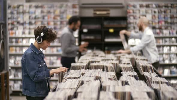 Thumbnail for Diverse Customers Chatting and Swaying to Music in Record Shop