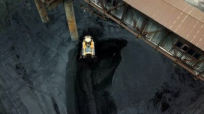 Bulldozer Sorts Coal