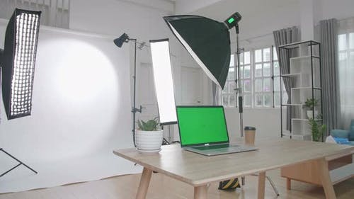 Photo Studio With Professional Equipment And Green Screen Laptop Computer Display