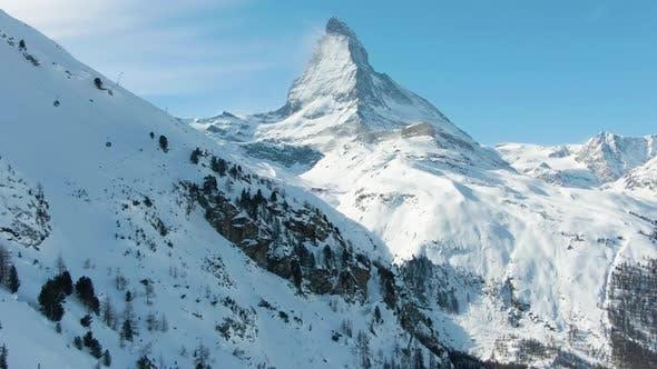 Thumbnail for Matterhorn Mountain in Winter Sunny Day. Swiss Alps. Switzerland. Aerial View. Medium Shot