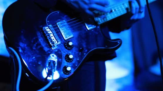 Guitarist Playing on Electric Guitar at Live Concert