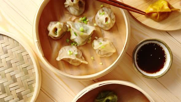 Thumbnail for Traditional Chinese Dumplings Served in the Wooden Bamboo Steamer