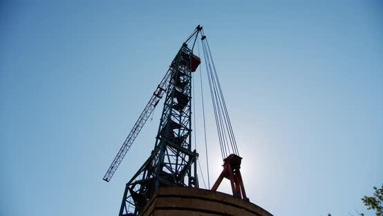 Thumbnail for Crane Rotate at Building Construction Site, Architecture Apartments. Wide Shot