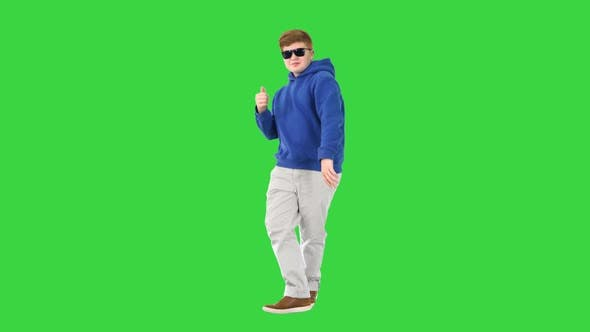 Thumbnail for Casual Boy in Sunglasses Walking and Dancing on a Green Screen, Chroma Key
