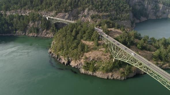 Thumbnail for Beautiful Aerial Of Cars On Road Trip Crossing Large Bridge Between Pacific Northwest Ocean Islands