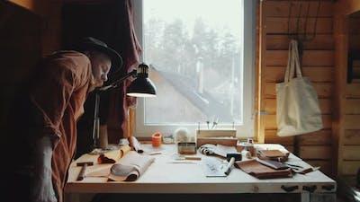 Craftsman Sitting at Desk in Workshop