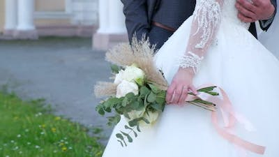 Closeup of the Bride Holding Her Wedding Bouquet