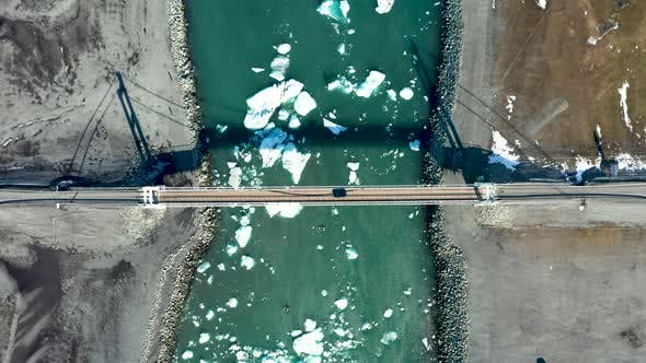Thumbnail for Aerial View of the Bridge, Glacial Lagoon and Icebergs. Iceland in Early Spring