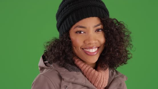 Thumbnail for Beautiful Black woman smiling and laughing in winter clothes on greenscreen