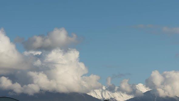 Snowy Mountain Against Cloudy Sky
