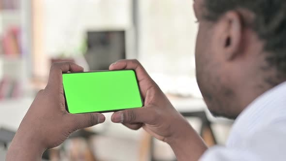 Thumbnail for Chroma Key, African Man Holding Smartphone Horizontal