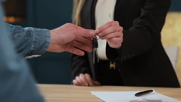 Thumbnail for Business, Real Estate, Deal and People Concept - Woman Giving House Keys To Man at Office.