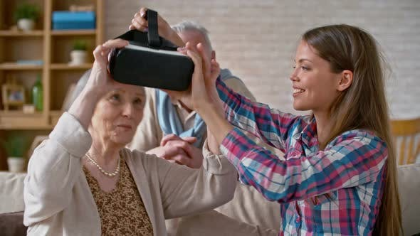 Thumbnail for Woman Experiencing Virtual Reality with Grandparents