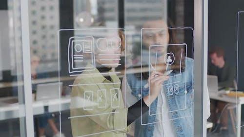 UI Designers Brainstorming Ideas about App Interface