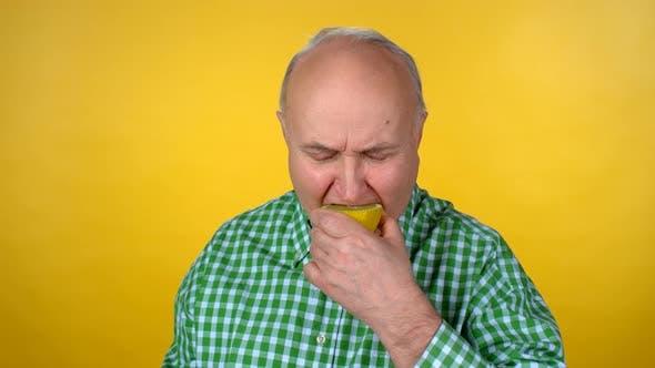 Thumbnail for Senior Man Eating Orange