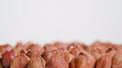 Red Hazelnuts Rotate on a White Background