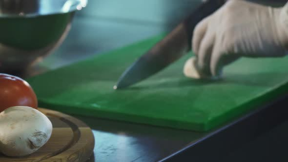Thumbnail for Cropped Shot of a Chef Slicing Muschrooms on Cutting Board