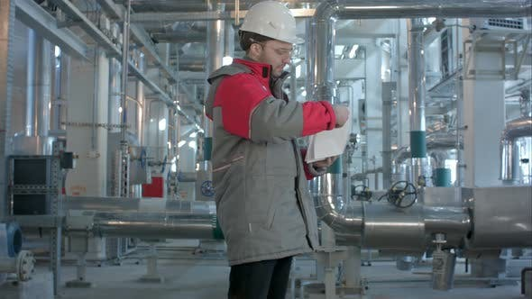 Thumbnail for Mechanical Inspector Does Inspection on a Plant