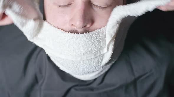 Thumbnail for Applying Hot Towel to face at Barbershop