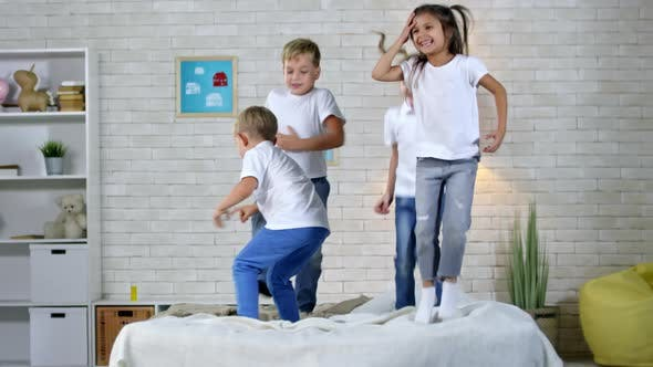 Thumbnail for Four Children Jumping on Bed