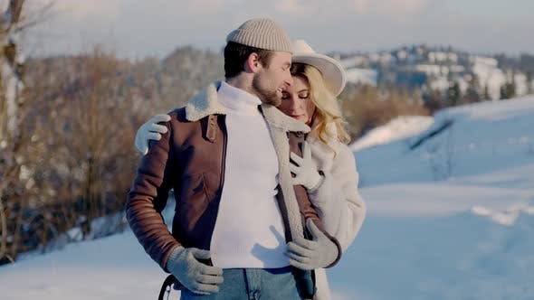 Couple Walking in Snowy Mountains