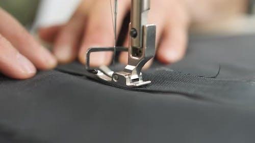 Sewing a stitch