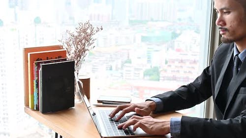 businessman typing a computer keyboard, working at the office or work from home
