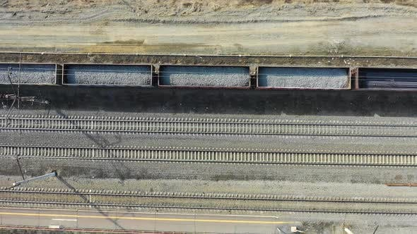 Cover Image for Freight Train Carries with Coal an Electric Locomotive - Aerial Footge, Top View